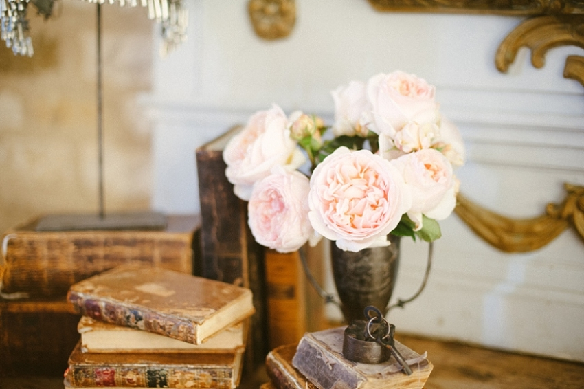 elizabeth-messina-vintage-books-silver-cup-floral-arrangement