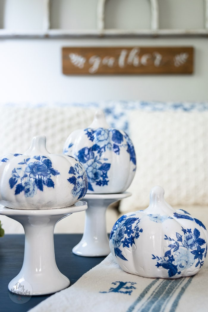 close up of glossy blue and white floral pumpkins