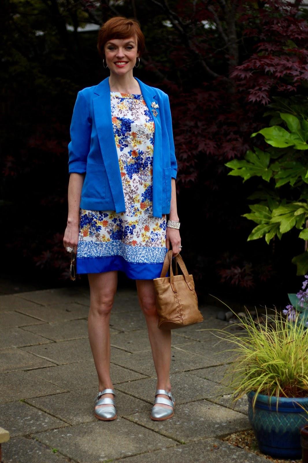Fake  Fabulous |Wardrobe malfunction, clinging fabrics | Blue, yellow and orange floral dress & silver sandals
