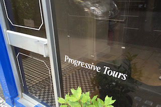 Detail Photo of Front Window of Progressive Tours, 12 Porchester Place, London W2