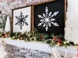 black and white snowflake signs on mantle
