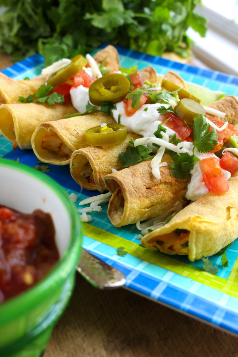 Air Fryer Chicken Taquitos have a crispy tortilla outside and a delicious, cheesy, salsa chicken inside. They make a great appetizer, main dish, or snack! #airfryer #chickenrecipe #taquitos