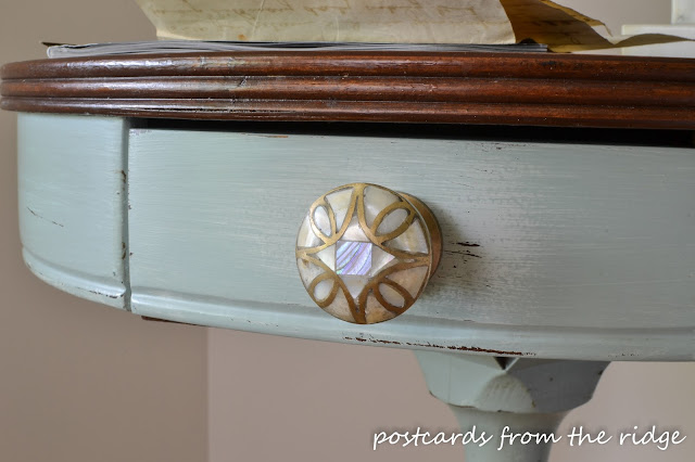 Gorgeous Anthro knob and layered paint give this drum table a nice update.