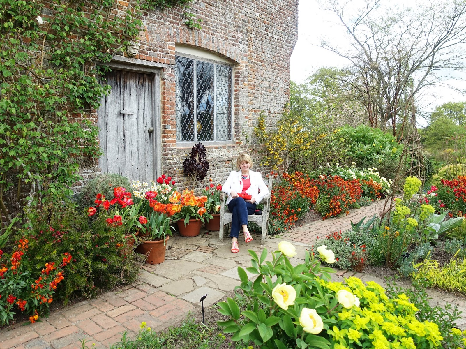 Seated among the fragrant wallflowers at Sissinghurst Castle Garden
