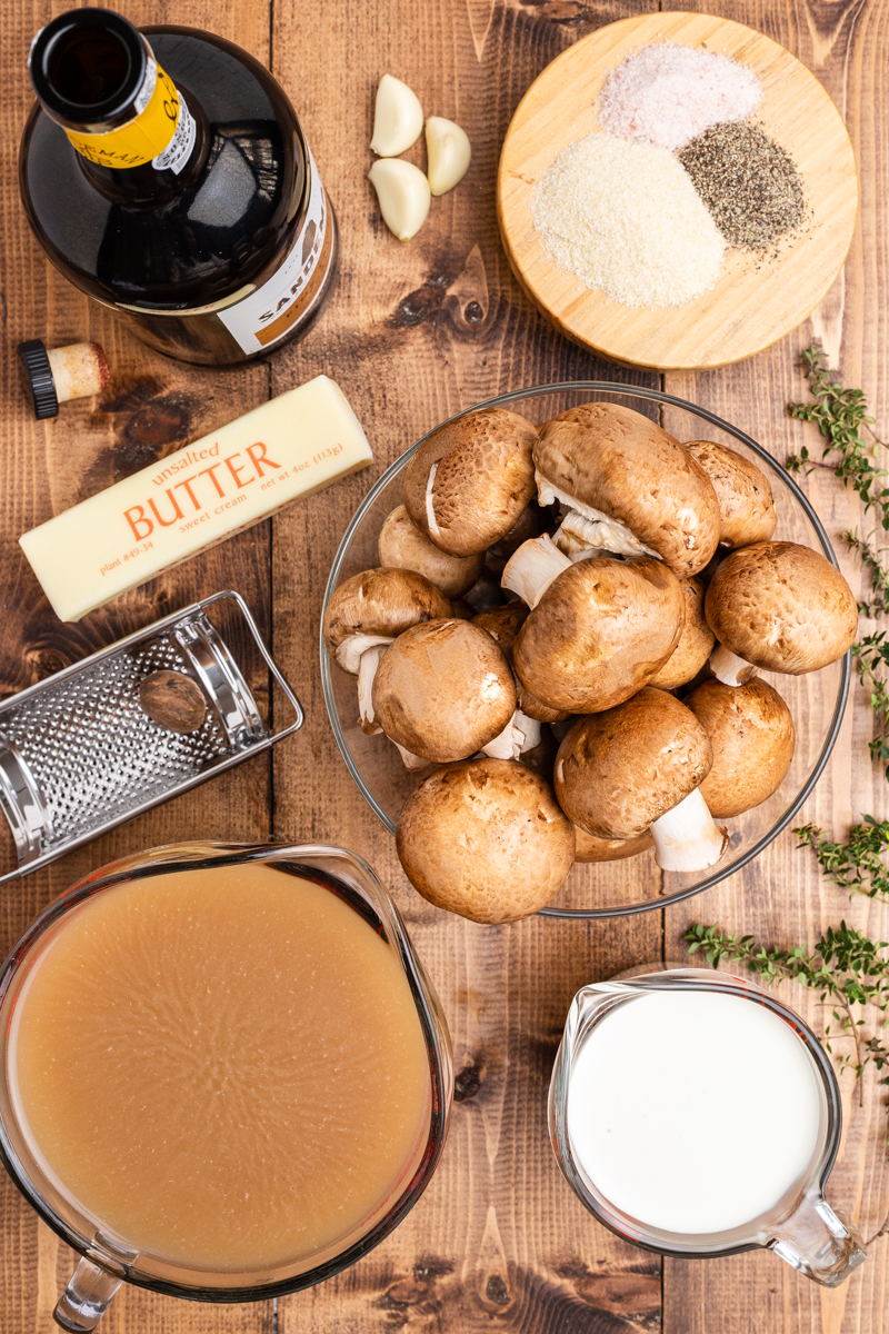 Overhead photo of the ingredients needed to make Keto Cream of Mushroom Soup on a wooden table.