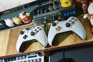 white Xbox one controllers