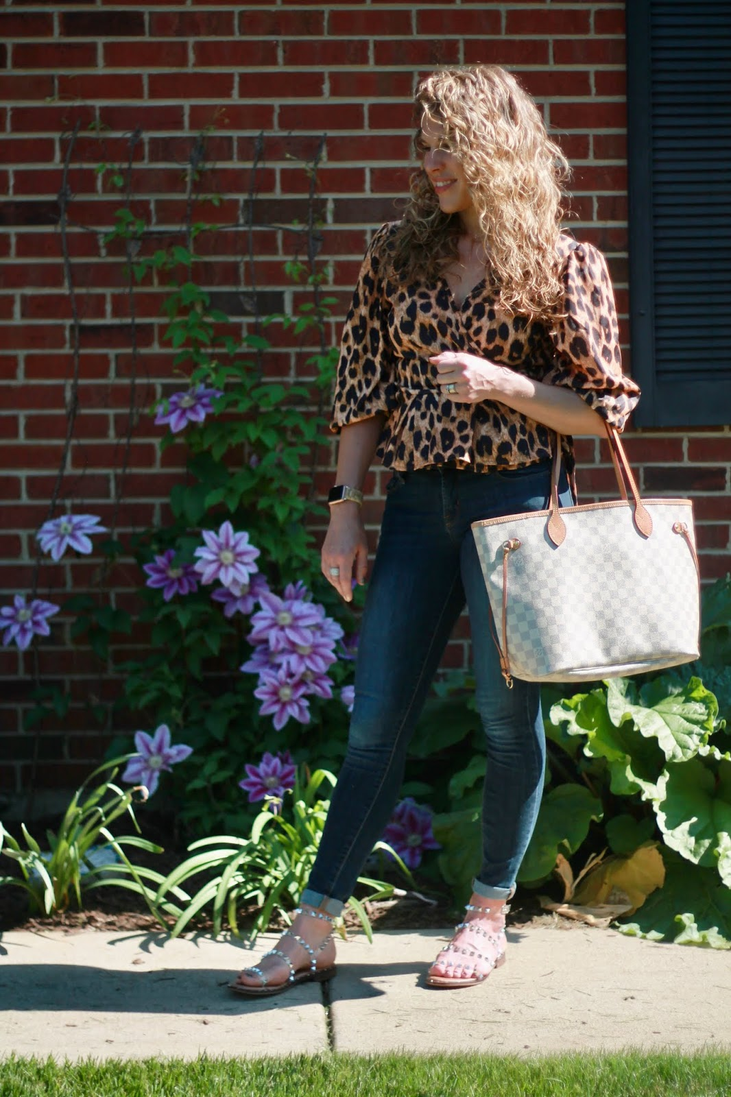 leopard peplum top, rockstar skinny jeans, steve madden clear travel sandals, LV azure neverfull, leopard spring outfit