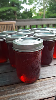 homemade strawberry jam on a porch table