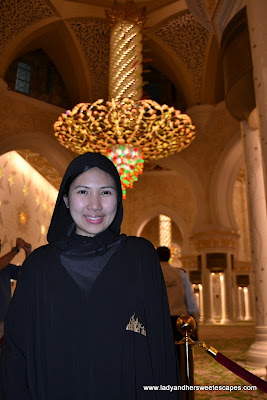 Lady at Sheikh Zayed Grand Mosque's main prayer hall
