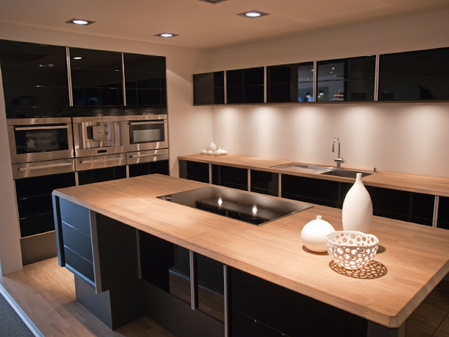 Kitchen style using beautiful color texture and light Kitchen style using beautiful color texture and light Contemporary kitchen with black and stainless steel cabinets and light wood countertops