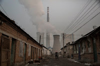 A coal-fired power plant on the outskirts of Beijing. China's retreat from plans to build dozens of additional plants has raised hopes it is serious about clean energy. (Credit: Kevin Frayer/Getty Images) Click to Enlarge.
