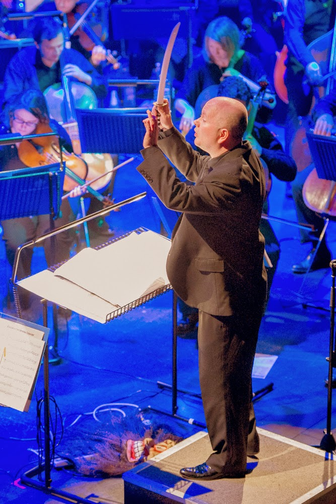 Benjamin Pope conducting with a cutlass, First Time Live with the RPO in Doncaster on Tue 25 March. Photo credit Paul Coghlin.