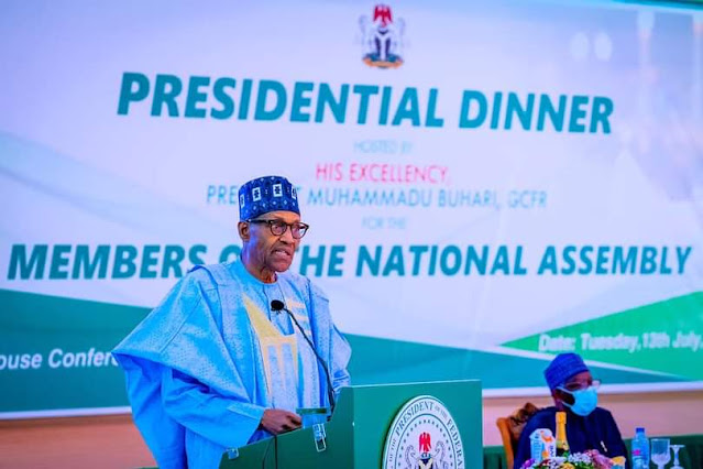 """Alt: = """"picture of president Buhari at presidential dinner with national assembly members"""""""