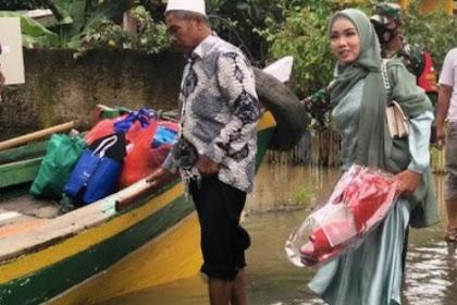 Perjuangan Aisyah terjang banjir Pandeglang naik perahu hadiri wisuda