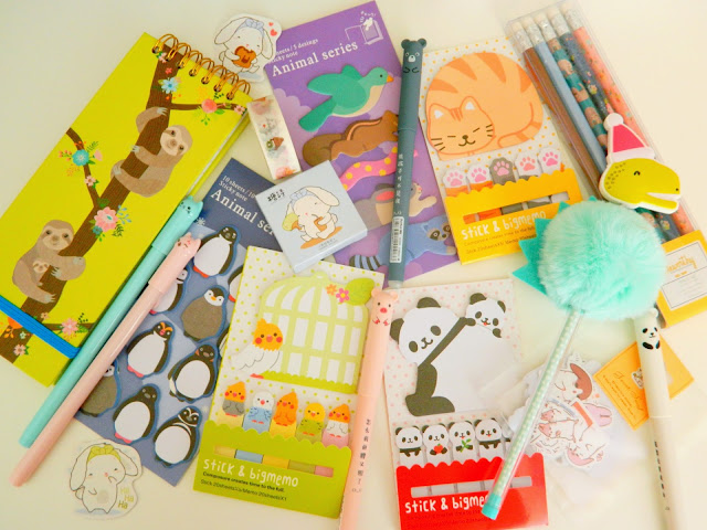 a photo showing various cute stationery items; pens, sticky notes, notebooks