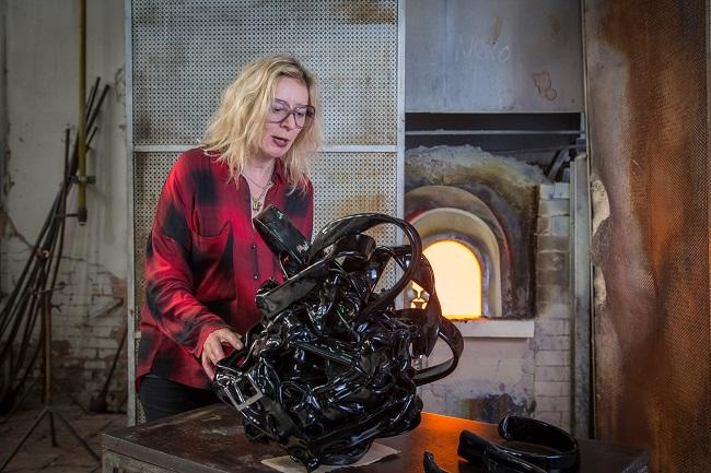 "Monica Bonvicini works on her glass artwork ""Bonded"""