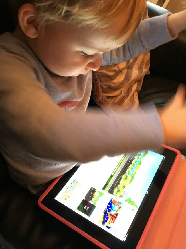 toddler-looking-at-ipad-and-waving-arms
