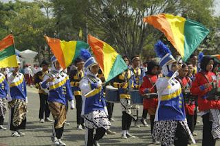 Adu  Kreasi  Dalam Harmonisasi Marching Band