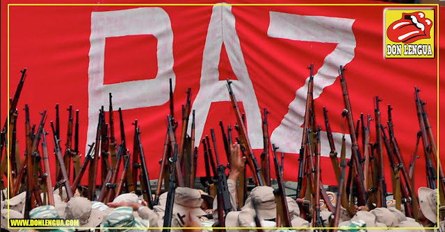 Esta pancarta de Maduro lo dice todo con sus cubanos armados por debajo