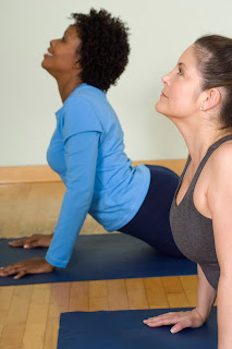 Two women practicing yoga