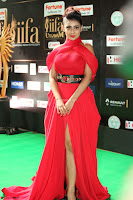 Apoorva in a Stunning Tight Leg Split Sleeveless Red Gown at IIFA Utsavam Awards 010.JPG
