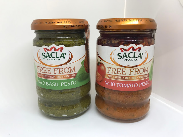 Two jars of Sacla pesto a green jar and a red jar
