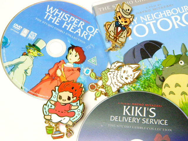 A photo showing a collection of Studio Ghibli DVDs and enamel pins by PokoPins