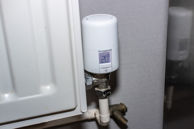 A close up of the hive radiator valve on a radiator set to heat to 20 degrees c