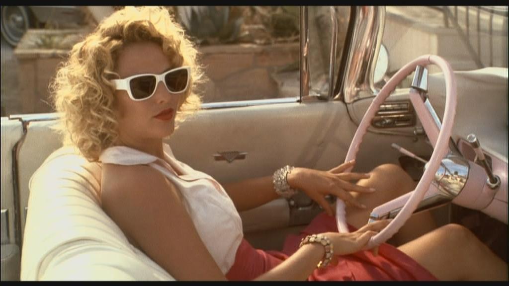 """Virginia Madsen 1959 pink Cadillac convertible """"The Hot Spot"""" 1990 animatedfilmreviews.blogspot.com"""
