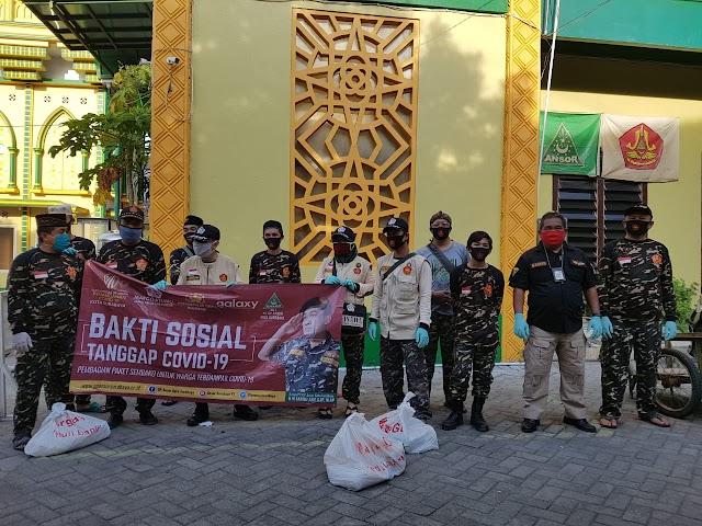 Pembagian Sembako PC GP Ansor Kota Surabaya Oleh Ansor Ranting Sutorejo Pada Masyarakat Terdampak Covid-19