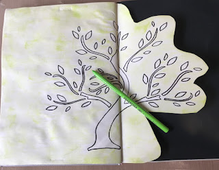 image tree outline in art journal with green pencil