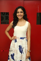 Actress Ritu Varma Stills in White Floral Short Dress at Kesava Movie Success Meet .COM 0076.JPG