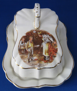 https://timewasantiques.net/products/dickens-ware-oliver-twist-butter-dish-cheese-dome-2-piece-1920s-lancaster?_pos=5&_sid=91cc17960&_ss=r