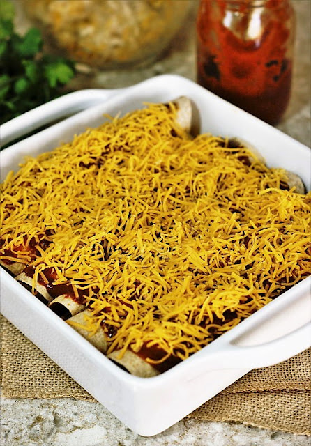 Simple Chicken Enchiladas Topped with Shredded Cheese Image