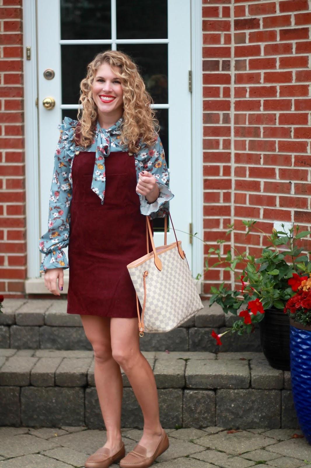 burgundy overall dress, light blue floral blouse, LV azure neverfull, cognac loafers