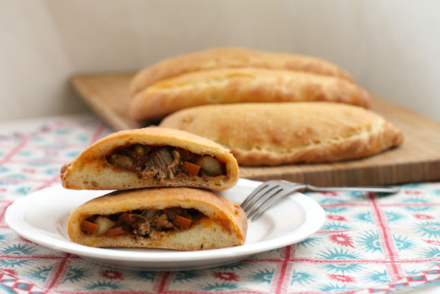 Food Lust People Love: Spicy Beef Curry Calzones feature a thick rich beef curry inside and a soft naan bread outside. They are like eating your curry by scooping it up with naan, but in a less messy, more portable way.