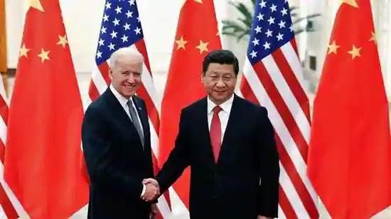 Xi Jinping and Joe Biden handshake