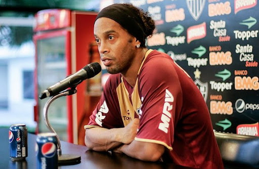 Ronaldinho is pictured alongside a can of Pepsi during a press conference