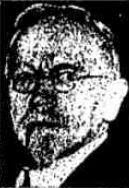 Newspaper headshot of a man, middle-aged or slightly older, with a receding hairline, goatee, and wire-rim glasses