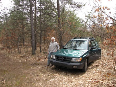 car parked in woods