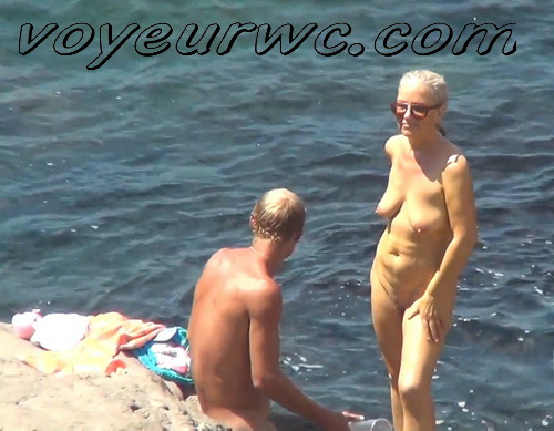 Beach 2330-2338 (Naked women caught on beach spy cam relaxing and enjoying nudity)