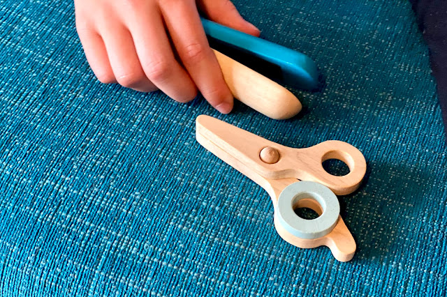 close up of wooden hair straightener and scissors showing they have hinged parts