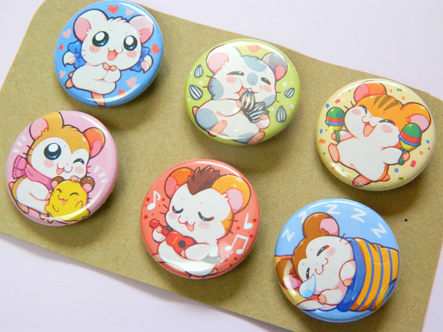 A set of 6 button badges showing characters from an anime, Hamtaro