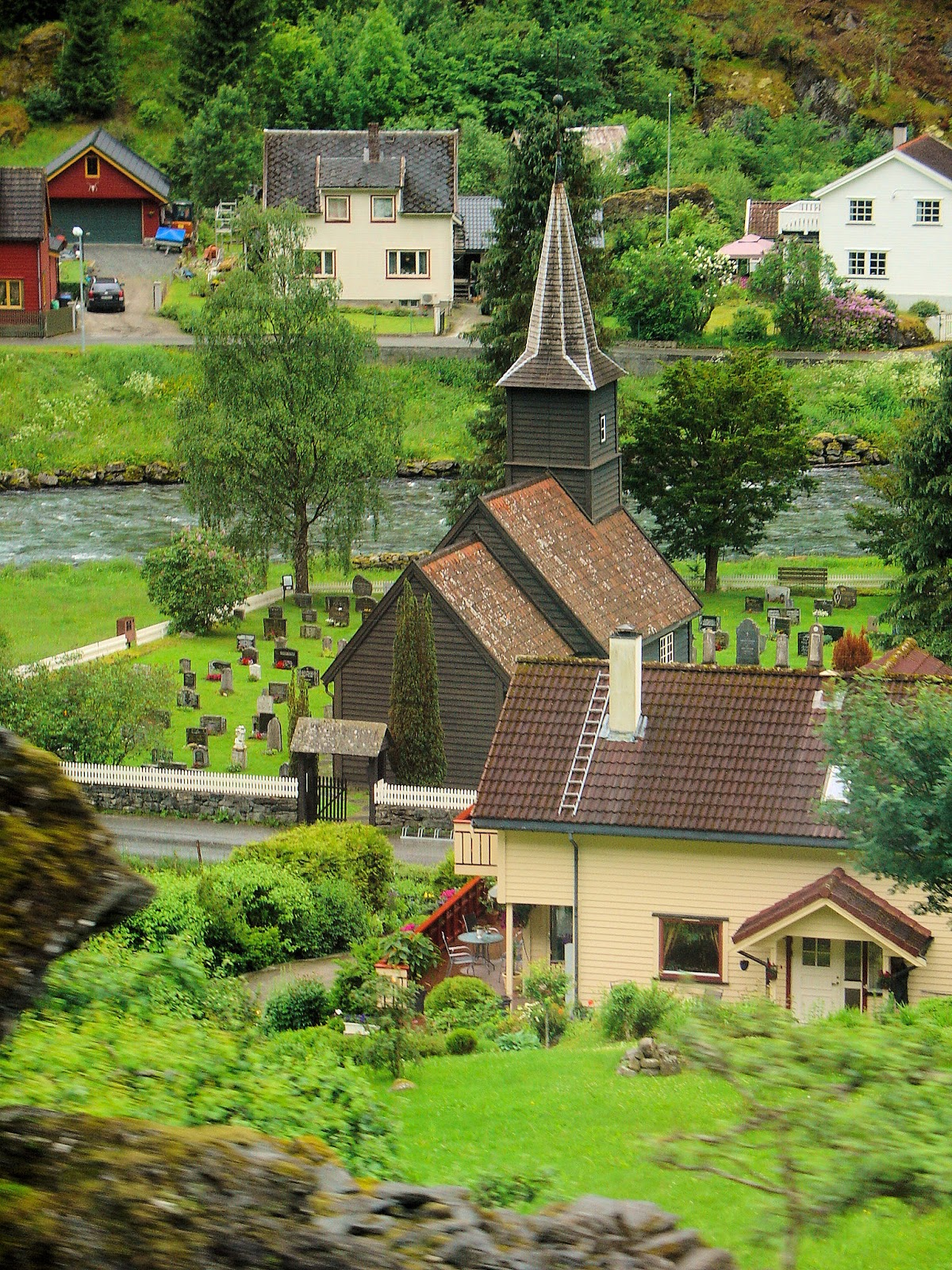 Storybook village of Flåm as seen from Flåm Railway.