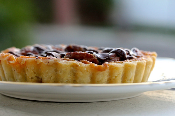 Bittersweet Chocolate Caramel Pecan Tarts with a chocolate topping