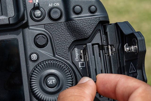 EOS-1D X Mark III body open with CF Express card slots