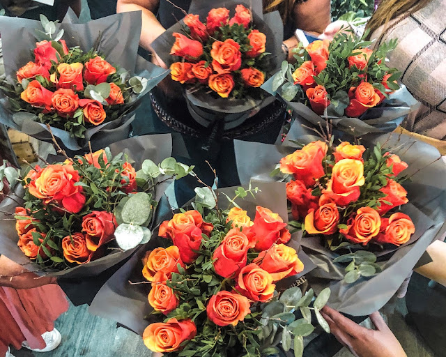 Orange roses- six examples of flower arrangments at a floristry class in Newcastle