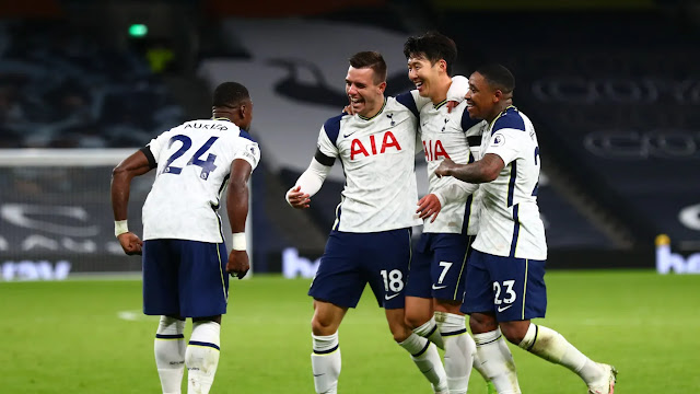 Tottenham hotspurs players celebrate with Lo Celso after scoring the second against Man city in their Premier League win