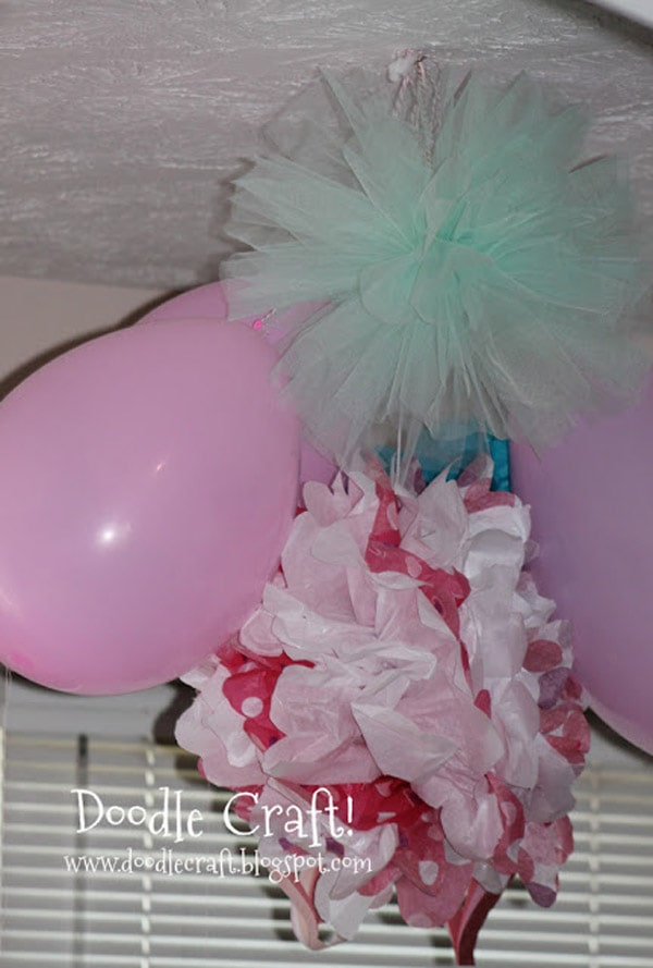 Make a pom pom out of tulle or netting for the perfect hanging decoration
