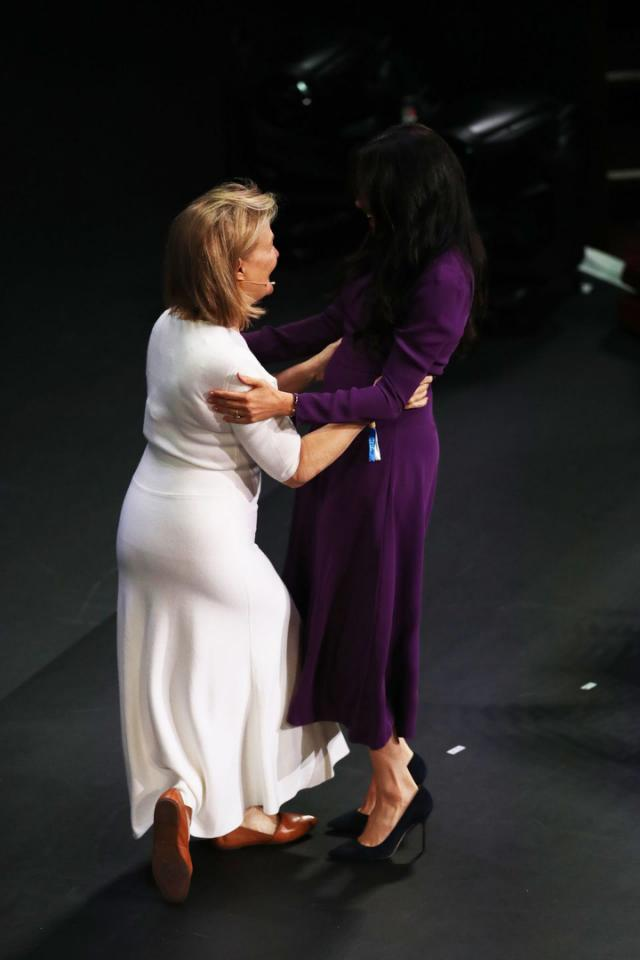 Meghan Markle engaged in an awkward hug onstage